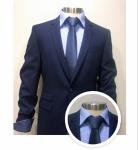 Pak blauw met blauw hemd en blauwe das