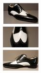 Schoen Grège in zwart en wit leer